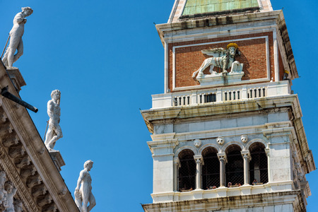 Campanile with an image of a lion on the Piazza San Marco, or St Marks Square, in Venice, Italy. The lion is a symbol of Venice.