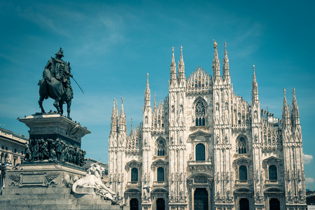 The famous Milan Cathedral (Duomo di Milano) and monument to Victor Emmanuel II on the Piazza del Duomo in Milan, Italy. Milan Duomo is the largest church in Italy.