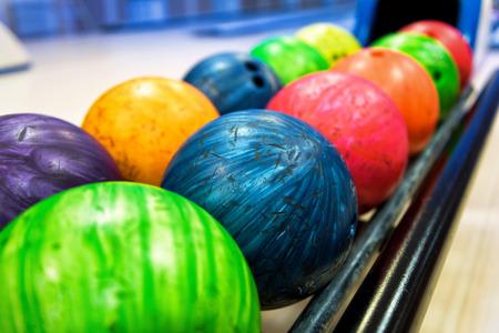 Colorful bowling balls in return machine