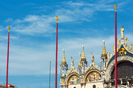 Basilica di San Marco (Saint Marks Basilica) on the blue sky background in Venice, Italy. Basilica di San Marco is the main tourist attraction of Venice. Stock Photo