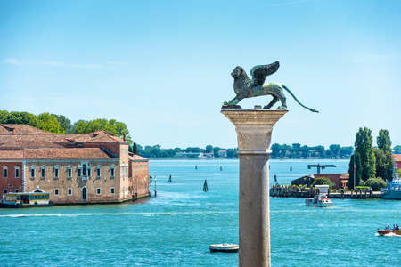 winged lion: The famous ancient winged lion sculpture on the Piazza San Marco in Venice, Italy. The lion is a symbol of Venice.