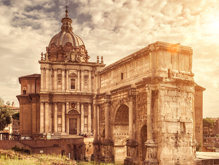 severus: The Roman Forum, Rome, Italy. Triumphal arch of Septimius Severus and medieval church of Santi Luca e Martina. Roman Forum is one of the main tourist attractions of Rome.