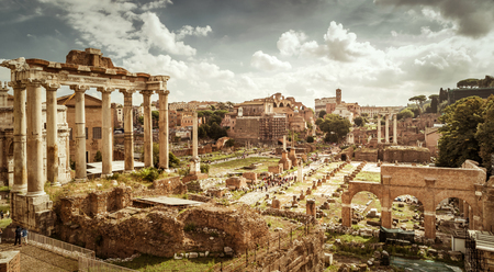 Panoramic view of the Roman Forum in Rome, Italy. The Roman Forum is the remains of architecture of the Roman Empire and is one of the main tourist attractions of Rome.