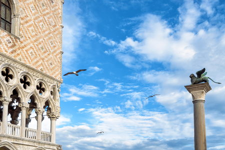 Piazza San Marco, or St Mark`s Square, in Venice, Italy. Doges Palace and column with the famous winged lion. It is the main tourist destination in Venice.