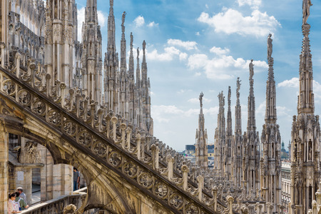 Milan, Italy - May 16, 2017: The roof of the Milan Cathedral (Duomo di Milano). Milan Duomo is the largest church in Italy and the fifth largest in the world.