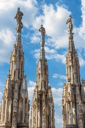 milánó: Marble statues on the stone spiers of the roof of the Milan Cathedral (Duomo di Milano) in Milan, italy. Milan Duomo is the largest church in Italy and the fifth largest in the world.