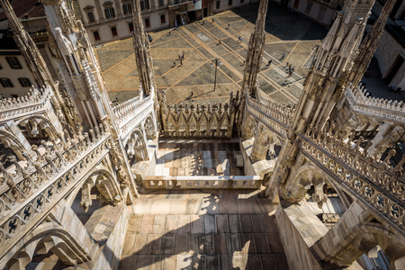 milánó: The terrace of the Milan Cathedral (Duomo di Milano) in Milan, Italy. View from rooftop. Milan Duomo is the largest church in Italy and the fifth largest in the world.