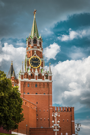 The Moscow Kremlin with the Spasskaya tower in the Red Square, Russia. The Moscow Kremlin is the residence of the Russian president and the main tourist attraction of Moscow. Editorial