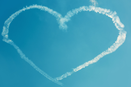 inversion: A heart in the blue sky from skywriting planes at an air show Stock Photo
