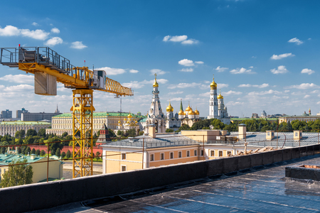 famous industries: Modern urban construction in central Moscow, Russia. Moscow Kremlin in the background.