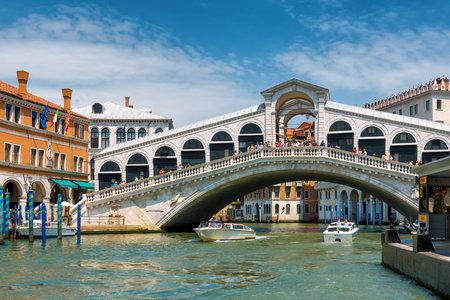 Venice, Italy - May 18, 2017: The old Rialto Bridge over the Grand Canal. Rialto Bridge (Ponte di Rialto) is one of the main tourist attractions of Venice. Editorial