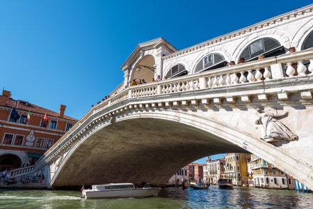 Venice, Italy - May 21, 2017: Rialto Bridge with tourists over the Grand Canal. Rialto Bridge (Ponte di Rialto) is one of the main tourist attractions of Venice. Editorial