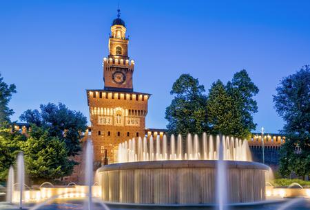 Sforza Castel (Castello Sforzesco) at night in Milan, Italy. This castle was built in the 15th century by Francesco Sforza, Duke of Milan.