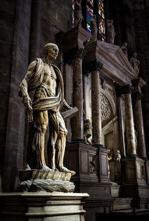 milánó: Milan, Italy - May 16, 2017:  The famous statue of Saint Bartholomew Flayed  in the Milan Cathedral (Duomo di Milano). Milan Duomo is the largest church in Italy and the fifth largest in the world.
