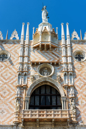 Doge`s Palace, or Palazzo Ducale, in Venice, Italy. Detail of the facade. Dode`s Palace is one of the main tourist destination in Venice.