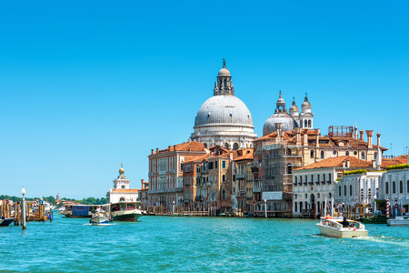 Basilica of Santa Maria della Salute on the Grand Canal in Venice, Italy. Grand Canal is one of the major water-traffic corridors in Venice.