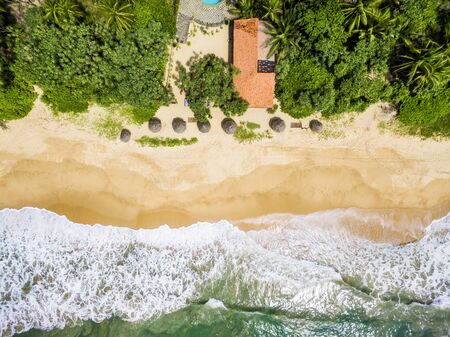 Aerial view of tropical beach with a single hotel Stock Photo