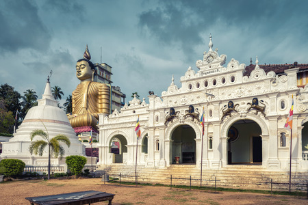 Wewurukannala Vihara is the old Buddhist temple in the town of Dickwella, Sri Lanka. A 50m-high seated Buddha statue is the largest in Sri Lanka. Stock Photo