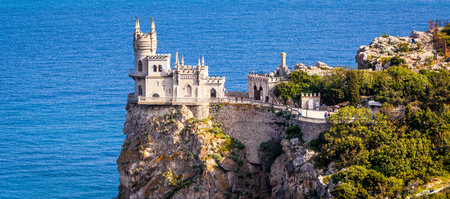 Panoramic view of the castle Swallows Nest on the rock over the Black Sea in Crimea, Russia. This castle is a symbol of Crimea. Editorial