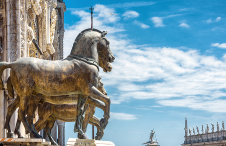Ancient bronze horses of the Basilica di San Marco over the Piazza San Marco, or St Mark`s Square, in Venice, Italy. This is the main square of Venice. Stock Photo