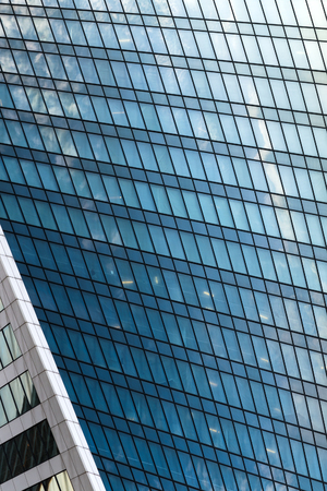 Architecture detail of modern building, glass facade with reflections Banque d'images