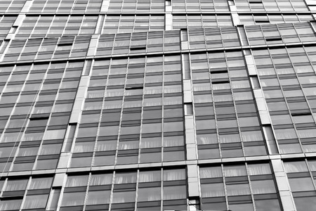Architecture detail of modern building exterior, glass facade, black and white