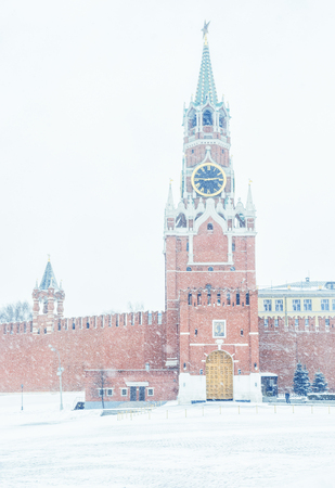 The Moscow Kremlin with Spasskaya tower on the Red Square, Russia. The Moscow Kremlin is the residence of the Russian president and the main tourist attraction of Moscow.