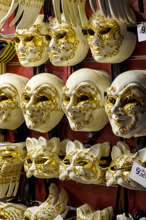 Traditional venetian masks in Venice, Italy. Venetian carnival is an annual costume festival, which attracts many tourists.