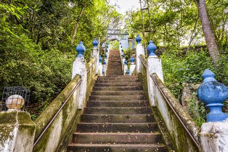 Stairs in ancient Buddhist rock temple in Mulkirigala, Sri Lanka Stock Photo
