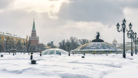 Moscow Kremlin and Manezhnaya Square in the winter. Panoramic view of central Moscow during snowfall.