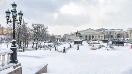 Moscow, Russia - Febraury 5, 2018: Manezhnaya Square in the winter. Panoramic view of central Moscow during snowfall.