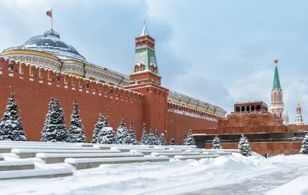 Moscow Kremlin with Lenins Mausoleum on the Red Square during snowfall in winter, Moscow, Russia. The Red Square is the main tourist attraction of Moscow.