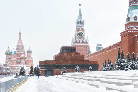 Red Square in winter, Moscow, Russia. Red Square is the main tourist attraction of Moscow. Snowy winter in Russia. Moscow Kremlin during snowfall. Historical architecture and landscape of Moscow.