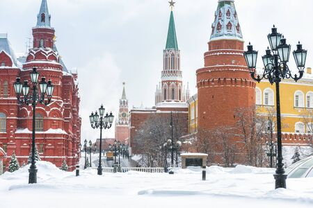 Moscow Kremlin at the Manege Square in winter, Russia. Central Moscow during snowfall. Manege (Manezhnaya) Square is one of main travel attractions of Moscow. Historical architecture and landscape of Moscow.