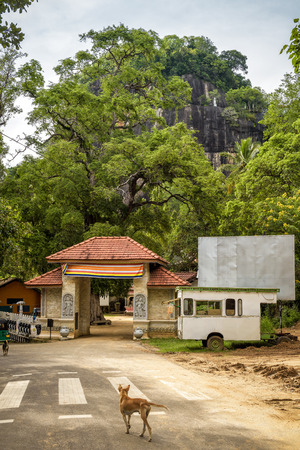 Entrance to the ancient Buddhist rock temple in Mulkirigala, Sri Lanka. Old religious architecture and landscape of Sri Lanka. Best travel destinations in Sri Lanka.