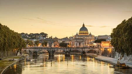 Rome at night, Italy. Sant`Angelo bridge and St Peters Basilica. Rome landmark. Saint Peters Basilica (San Pietro) is one of main travel attractions of Rome. Panoramic scenic view of night Rome.