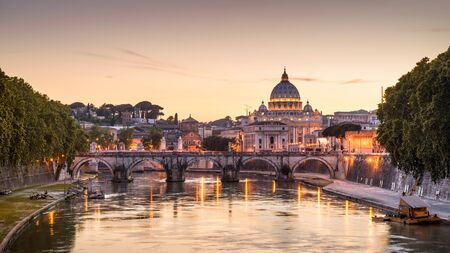 Rome at night, Italy. Sant`Angelo bridge and St Peters Basilica. Rome landmark. Saint Peters Basilica (San Pietro) is one of main travel attractions of Rome. Scenic night view of Rome and Vatican.