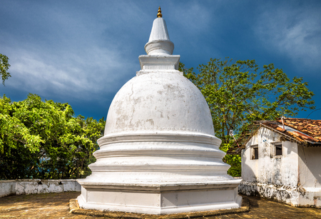 Buddhist stupa in the temple of Mulkirigala, Sri Lanka. Mulkirigala Raja Maha Vihara is an ancient Buddhist rock temple complex. The old stupa in the sunlight in Sri Lanka. Travel across Sri Lanka.