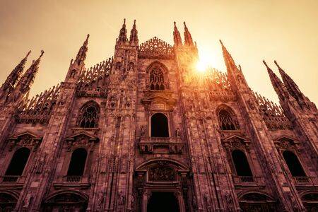 Milan Cathedral (Duomo di Milano) in the sunlight in Milan, Italy. Milan Cathedral is the largest church in Italy and the fifth largest in the world. Historical architecture and landmarks of Milan.