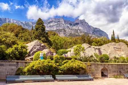 CRIMEA - MAY 20, 2016: The garden at the Vorontsov Palace in Crimea. It is one of the main tourist attractions of Crimea. Mount Ai-Petri in the distance. Beautiful panoramic view of the Crimea coast.