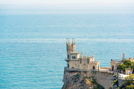 Castle Swallows Nest over the Black Sea on sunny day, Crimea, Russia. Famous Crimea landmark. Swallows Nest is a symbol of Crimea. Aerial panoramic view of the Crimea coast with seascape in summer.