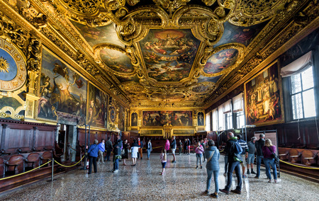Venice, Italy - May 20, 2017: Interior of Doge`s Palace (Palazzo Ducale), the Senate Chamber. Doge`s Palace is one of the main tourist attractions in Venice. People walk inside the Doge`s Palace.