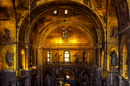 Venice, Italy - May 21, 2017: Luxurious interior of St Mark`s Basilica in Venice. St Mark`s Basilica (San Marco) is the best-known sights of Venice. Ancient gold decoration inside the Venice landmark. Редакционное