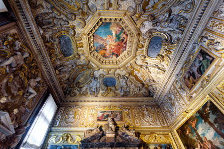 Venice, Italy - May 20, 2017: Inside the Doge`s Palace or Palazzo Ducale. Doge`s Palace is one of the main attractions in Venice. Luxurious ornate interior of one of the rooms in Doge`s Palace. Editöryel