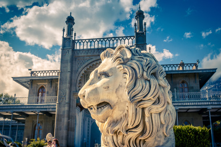 Alupka, Crimea - May 20, 2016: Statue of lion in front of Vorontsov Palace in Crimea, Russia. Vorontsov Palace is one of the best-known sights in Crimea. Historical architecture in Crimea.