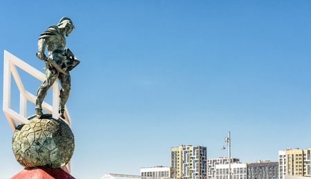 Moscow, Russia - May 11, 2018: Statue of Spartacus at Spartak stadium. Ancient Roman gladiator on blue sky background with copy space. Spartak Stadium has been selected for the 2018 FIFA World Cup.