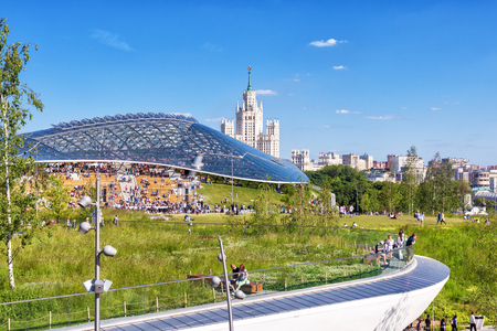 Moscow - June 17, 2018:  Modern amphitheater with glass dome in Zaryadye Park in Moscow, Russia. Zaryadye is one of the main landmarks of Moscow. Scenic panoramic view of the Moscow center in summer.