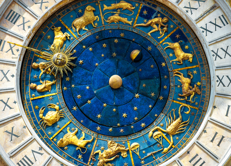 Ancient clock Torre dellOrologio on St Marks Square (San Marco) in Venice. Detail with clock face and astrological Zodiac signs. Vintage dial close-up, medieval art of Italy. Astrology concept. Sajtókép