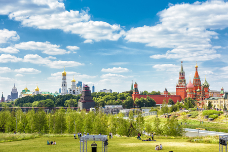Zaryadye Park overlooking the Moscow Kremlin and St Basils Cathedral, Russia. Zaryadye is the one of the main tourist attractions of Moscow. Panoramic scenic view of Moscow centre in summer.