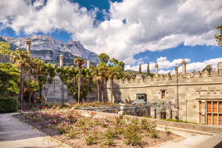 Crimea - May 20, 2016: Garden at Vorontsov Palace overlooking mount Ai-Petri in Crimea, Russia. Vorontsov Palace is one of the main landmark of Crimea. Architecture and nature of Southern Crimea.